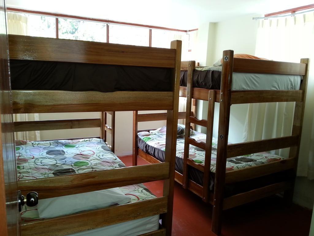 Dormitório com 4 camas ca Casa Machu Picchu - Foto: Casa Machu Picchu / Booking.com