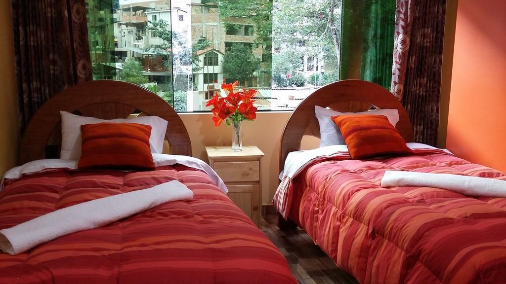 Quarto do Hostal Cusi Quyllor. Foto: Hostal Cusi Quyllor / Booking.com